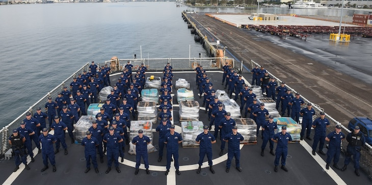 The crew of the Coast Guard Cutter Waesche poses with pallets holding more than 7.1 tons of contraband Friday at Tenth Avenue Marine Terminal in San Diego April 5, 2019.