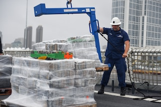 A Coastguardsman offloads contraband from the cutter at Tenth Avenue Marine Terminal in San Diego April 5, 2019.