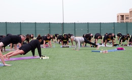 Paula LeBov, American Red Cross employee and Camp Arifjan Resiliency Program manager, teaches a yoga class during early morning physical fitness training April 3, 2019 at Camp Arifjan, Kuwait.