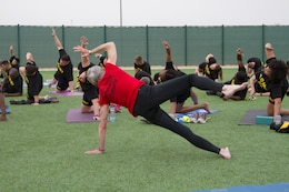 Paula LeBov, American Red Cross employee and Camp Arifjan Resiliency Program manager, instructs a yoga class for Soldiers April 3, 2019 at Camp Arifjan, Kuwait.
