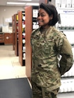 Maj. Amanda Ferguson, 628th Medical Group Pharmacy Flight commander, pauses in the newly renovated pharmacy facilities. Her vision of a remodel was recently completed, the goal of which is to make their patients' experiences better, faster and easier than in the past.