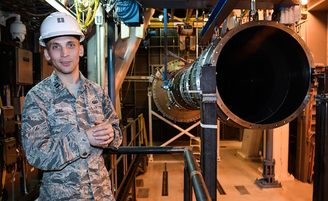 While standing in the Sea Level 2 test cell at Arnold Air Force Base, Capt. Jonathon Dias, test manager with the Aeropropulsion Combined Test Force at Arnold Air Force Base, speaks about the test capabilities of the cell. (U.S. Air Force photo by Jill Pickett)