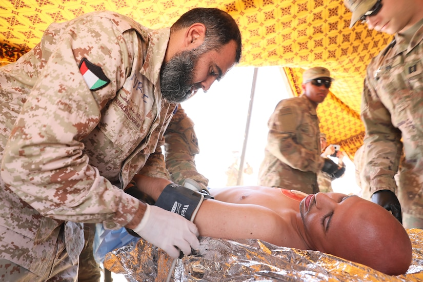 Kuwait Land Forces soldiers and U.S. Soldiers form 1st Battalion, 68th Armor Regiment, 3rd Armored Brigade Combat Team, 4th Infantry Division treat a simulated casualty during a combined training exercise at the Udairi Training Range on April 2, 2019. The training involved more than 200 Kuwaiti Land Forces and U.S. Soldiers, as well as medical staff from Al Jahra Hospital, and enabled U.S. and Kuwaiti forces to build upon their partnership and increase their ability to support each other.