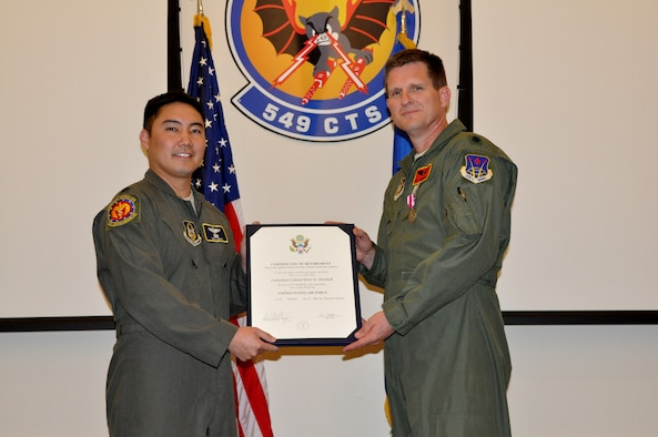 Lt. Col. Brett Brimhall, a 926th Aerospace Medicine Squadron flight surgeon and chief of medical staff, retires in a ceremony on Nellis Air Force Base, Nev., on April 7, 2019 after 24 years of military service.