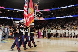 Marine Sgt. Amber Haddix, Sgt. Bree-Anna Perez, Sgt. Norma Gavilanes and Sgt. Carly Jones, all drill instructors at Marine Corps Recruit Depot Parris Island, South Carolina, march onto the Amalie Arena basketball court bearing rifles and the national ensign and Marine Corps colors for the national anthem at the National Collegiate Athletic Association Women's Final Four Basketball Tournament Championship in Tampa, Florida, April 7, 2019. The tournament ran in conjunction with the 2019 Women's Basketball Coaches Association Convention. The Marine Corps Recruiting Command has taken deliberate actions to increase diversity accessions and outreach by partnering with and attending engagement events such as WBCA, reprioritizing elements of advertising programs, increasing awareness of scholarships opportunities, and analyzing prospects and processing. The WBCA's mission is to promote women's basketball by unifying coaches at all levels to develop a reputable identity for the sport and to foster and promote the development of the game of basketball as a sport for women and girls. (U.S. Marine Corps photo by Cpl. Naomi May)