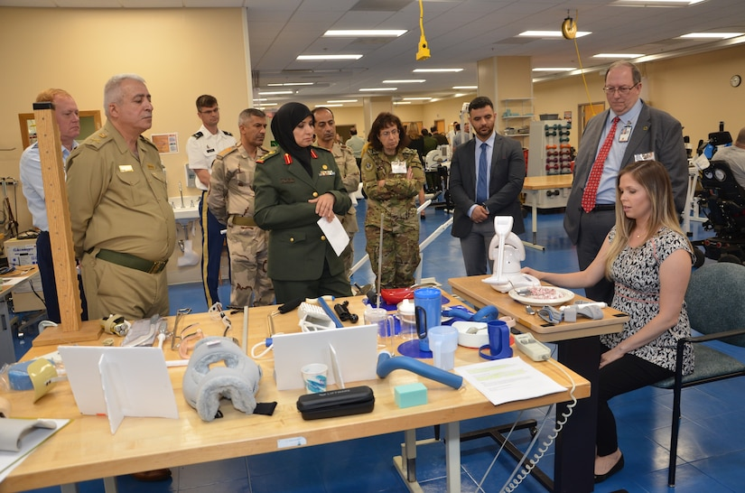 Military medical officials representing eighteen coalition and partner nations view a prosthetic component display during a tour of the James A. Haley Veteran's Hospital during USCENTCOM's Medical Security Cooperation Exchange, April 4, 2019. The biennial event provides a forum to exchange information intended to enhance medical capabilities in support of missions that include disaster response, humanitarian assistance, and combat and peacekeeping operations. (Courtesy Photo by Ed Drohan)