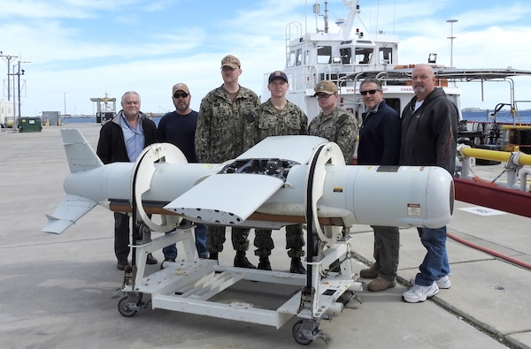 The AN/AQS-20C (Q-20C) Sonar Sensor Post Mission Analysis (PMA) Operators gather pier side March 15, 2019 with the Naval Surface Warfare Center Panama City Division (NSWC PCD) Q-20C project team's subject matter experts.