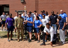 U.S. Air Force Chief Master Sgt. Lavor Kirkpatrick, 17th Training Wing command chief, and Col. Robert Ramirez, 17th TRW vice commander, join members of the 316th Training Squadron for a photo on Sports Day at the Mathis Fitness Center, Goodfellow Air Force Base, Texas, April 5, 2019. The 316th TRS dethroned the 315th Training Squadron who had taken first for the last two Sports Days (U.S. Air Force photo by Airman 1st Class Zachary Chapman/Released)
