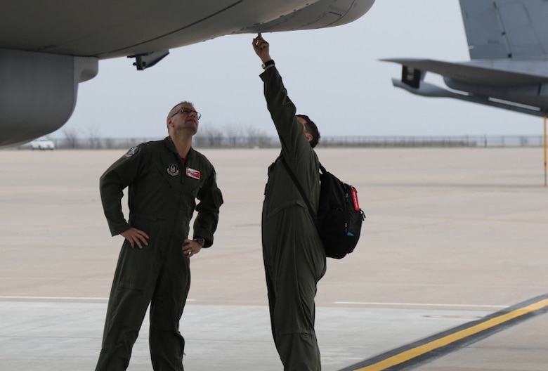 Master Sgt. Heath Hampton, Air Mobility Command KC-46 Test and Eval instructor, shows Col. Phil Heseltine, 931st Air Refueling Wing commander, some unique physical characteristics of the boom on the KC-46A Pegasus April 6, 2019, McConnell Air Force Base, Kan. The 931 ARW and the 22nd Air Refueling Wing conducted their first Total Force formation flight with the KC-46A. Col. Mark Baran, 22 ARW vice commander, piloted another aircraft in the formation