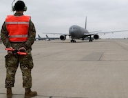 A Tech Sgt. Kurtis Woltemath, 931st Aircraft Maintenance Squadron crew chief, waits to begin marshaling the KC-46A Pegasus flown by Col. Mark Baran, 22nd Air Refueling Wing vice commander, for the first ever KC-46A Total Force formation flight between the 22 ARW and the 931st Air Refueling Wing April 6, 2019, at McConnell Air Force Base, Kan. The commanders of the 22 ARW and 931 ARW flew the Total Force formation. Col. Phil Heseltine, 931 ARW commander, flew another KC-46 in the formation.