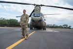 U.S. Army Capt. Jennifer West, 1-228th Aviation Regiment Bravo Company commander, stands by a CH-47 Chinook at Soto Cano Air Base, Honduras, April 4, 2019.
