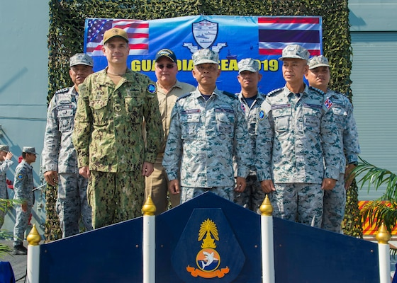 PHUKET, THAILAND (April 7, 2019) - U.S. and Royal Thai Navy leaders stand together during the opening ceremony for Guardian Sea 2019 on the flight deck of RTN frigate HTMS Bhumibol Adulyadej (FFG 471). Guardian Sea is a premier exercise that demonstrates both navies commitment to ensuring that they are ready to counter any threats together. (U.S. Navy photo by Mass Communication Specialist 2nd Class Christopher A. Veloicaza)