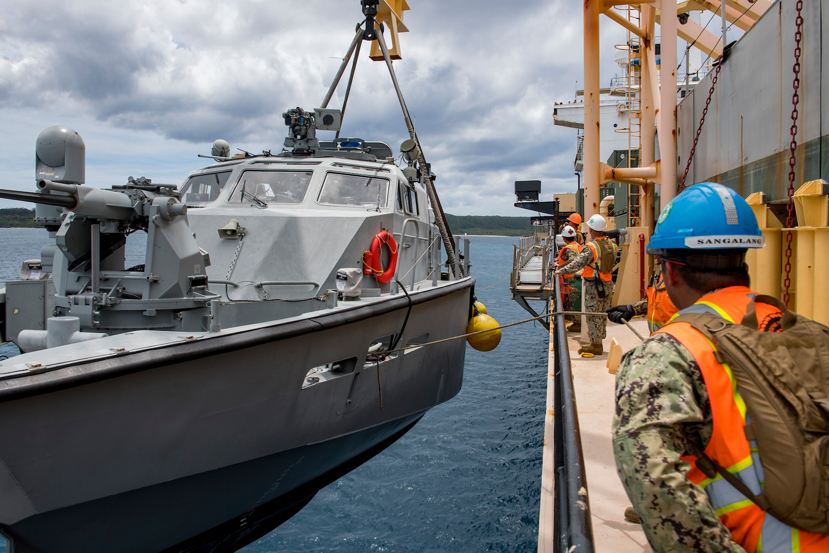 SANTA RITA, Guam (April 4, 2019) Sailors assigned to Navy Cargo Handling Battalion (NCHB) 1, Det. Guam, lift a Mark VI patrol boat assigned to Coastal Riverine Squadron (CRS) 2, Det. Guam, during a first-time proof of concept lift operation aboard the Military Sealift Command maritime prepositioning force ship USNS 2nd Lt. John P. Bobo (T-AK 3008). NCHB-1, Detachment Guam, assigned to Commander, Task Force 75, is the Navy's only active duty cargo handling battalion. They are a rapidly deployable unit of the Navy Expeditionary Combat Command, capable of loading and discharging ships and aircraft in all-climatic and threat conditions. (U.S. Navy photo by Mass Communication Specialist 2nd Class Jasen Moreno-Garcia/Released)