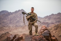 U.S. Marine Cpl. Frederick W. Maul, a designated marksman with 5th Platoon, Charlie Company, Fleet Anti-Terrorism Security Team, Central Command, holds the M110 Semi-Automatic Sniper System during a hike after conducting live-fire range operations. FASTCENT provides expeditionary antiterrorism and security forces to embassies, consulates and other vital national assets throughout the region.