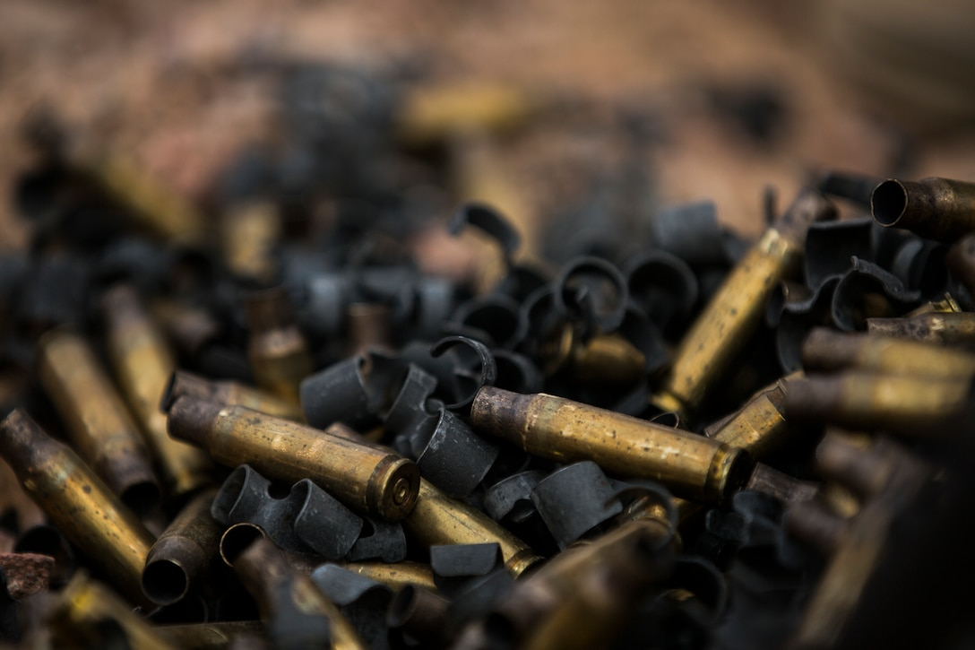 Spent brass casings of 7.62mm rounds, fired by Marines with 5th Platoon, Charlie Company, Fleet Anti-Terrorism Security Team, Central Command, lie on the ground. FASTCENT provides expeditionary antiterrorism and security forces to embassies, consulates and other vital national assets throughout the region.