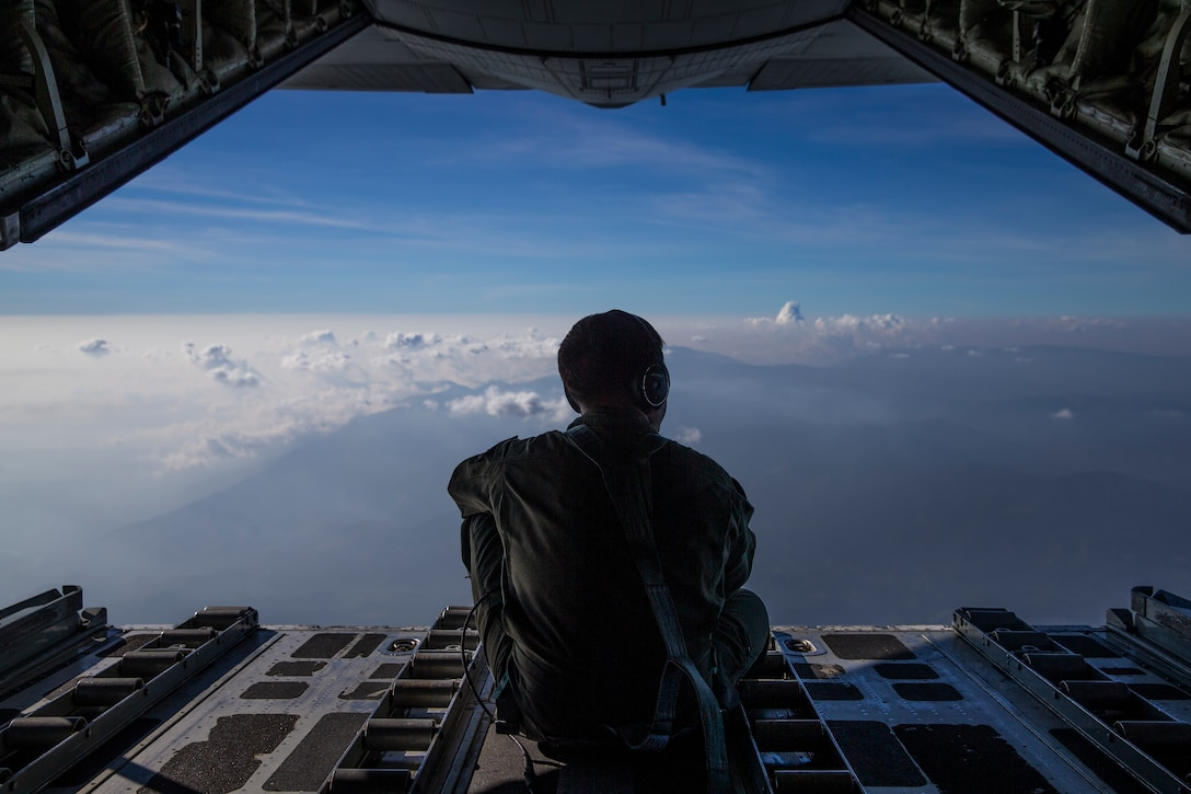 "U.S. Marine Corps Gunnery Sgt. David Law sits on the ramp of a KC-130 while flying over the Philippines near Colonel Ernesto Ravina Air Base, during Exercise Balikatan, April 8, 2019.  Balikatan is an annual exercise between the U.S. and the Philippines and comes from a Tagalog phrase meaning ""shoulder-to-shoulder,"" representing the partnership between the two countries. The exercise promotes regional security and humanitarian efforts for U.S. allies and partners. Law is a crewmaster with Marine Aerial Refueler Transport Squadron 152."