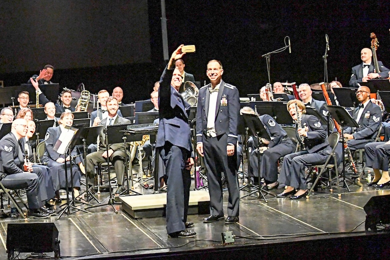 Col. Larry Shaw, 434th Air Refueling Wing commander, takes a selfie with the U.S. Air Force Band of Mid-America during their performance April 5, 2018 at McHale Auditorium in Logansport, Indiana. Each year the Band of Mid-America performs for millions of people throughout a 10-state region from the upper peninsula of Michigan to Arkansas. (U.S. Air Force photo/Douglas Hays)