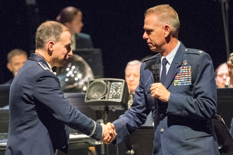 Col. Larry Shaw, 434th Air Refueling Wing Commander, right, thanks Lt. Col. Michael Willen, Air Force Band of Mid-America commander, following their performance April 5, 2019 at McHale Auditorium in Logansport, Indiana. Air Force bands communicate key DOD and Air Forces messages to a wide audience to instill patriotism, build partnerships, enhance the reputation of the Air Force and the United States, as well as demonstrate American values to the world. (U.S. Air Force photo/Douglas Hays)