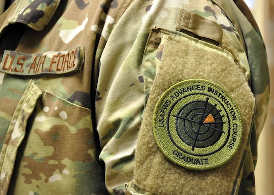 The 455th Air Expeditionary Wing intelligence flight chief is the first enlisted weapons school graduate to wear the new patch in Afghanistan. The patch was approved in October 2018. (U.S. Air Force photo by Capt. Anna-Marie Wyant)
