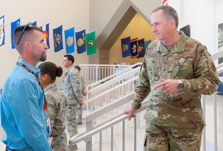 Air Force Chief of Staff Gen. David L. Goldfein talks with Scott Lilley of the Air Force Installation and Mission Support Center Security Office April 8 during a break between briefings at the Installation and Mission Support Weapons and Tactics Conference at Joint Base San Antonio-Lackland, Texas.