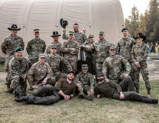 Group photo of the newly spurred troopers after the Order of the Spur induction ceremony held at the Yavoriv Combat training Center, Ukraine, April 8, 2019.