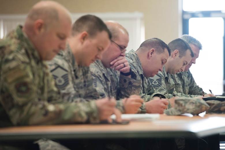 Airmen participating in the Homeland Security Exercise and Evaluation Program course fill out forms to receive their certification for completing the course. (U.S. Air National Guard photo by Senior Master Sgt. Emily Beightol-Deyerle)