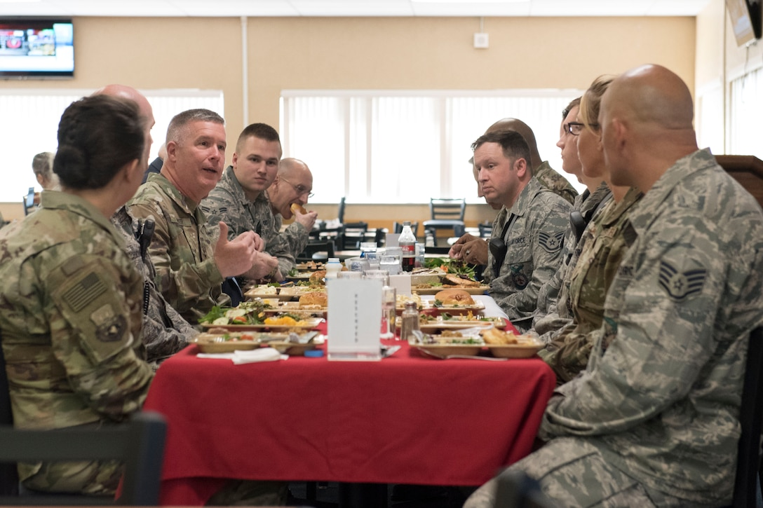 Maj. Gen. James Hoyer, the adjutant general for the West Virginia National Guard, center left, eats lunch with the 167th Airlift Wing's Outstanding Airmen of the Year and five firefighters who recently saved a man from a burning vehicle, April 6, 2019. Hoyer and other state leadership spent the day at the wing, meeting with wing leadership and attending various events. (U.S. Air National Guard photo by Tech. Sgt. Jodie Witmer)