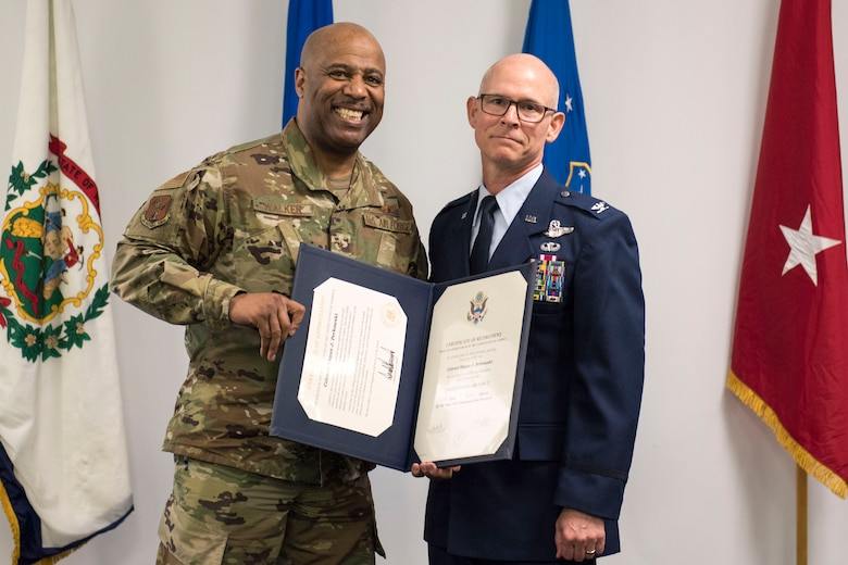 Brig. Gen. Christopher Walker, the West Virginia National Guard's Assistant Adjutant General- Air, presents Col. Shaun Perkowski with his certificate of retirement during Perkowski's retirement ceremony. Perkowski was the 167th AW commander from October 2013- October 2018. (U.S. Air National Guard photo by Tech. Sgt. Jodie Witmer)