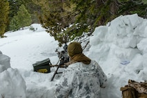 U.S Marine Corps Pfc. Daniel Furgison, machine gunner, 1st Battalion, 6th Marine Regiment, 2nd Marine Division, provides security during Mountain Training Exercise (MTX) 1-19, at Marine Corps Mountain Warfare Training Center, Bridgeport, Calif., March 22, 2019. The purpose of MTX is to prepare Marines for harsh weather conditions while enhancing winter warfare skills in cold weather environments. (U.S. Marine Corps photo by Pfc. Christy Yost)