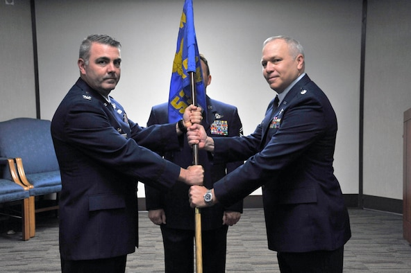 U.S. Air Force Reserve Lt. Col. Dwayne A. Russell (right) accepts command of the 53rd Weather Reconnaissance Squadron from Col. Brian May, 403d Operations Group commander during the 53rd Weather Reconnaissance Squadron change of command ceremony April 6, 2019 at Keesler Air Force Base, Miss. Col. Russell has been with the 53rd WRS since September 1996.  (U.S. Air Force Photo by Tech. Sgt. Sarah Loicano)