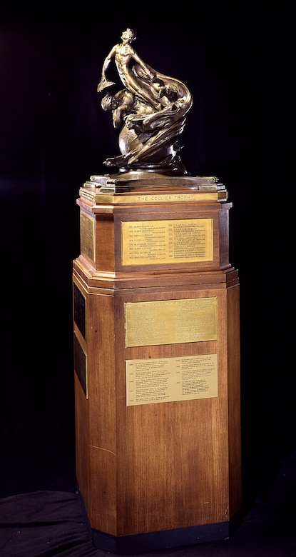 "The Collier Trophy was established in 1911 by Robert J. Collier, publisher and early President of the Aero Club of America. The trophy is administered by the National Aeronautic Association of the U.S.A. and is awarded annually for ""the greatest achievement in aeronautics or astronautics in America, with respect to improving the performance, efficiency, and safety of air or space vehicles, the value of which has been thoroughly demonstrated by actual use during the preceding year."" It is permanently housed at the Smithsonian National Air and Space Museum in Washington, D.C. (Photo courtesy of the Smithsonian Institution)"