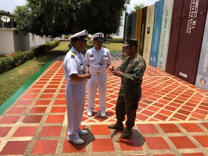 MGySgt Ronal Morales discusses the importance of Non-Commissioned Officer and enlisted education continuum to professionalize the Colombian Marine Corps with the Director and Sergeant Major of the Colombian NCO School in Covenas, Colombia.