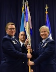 U.S. Air Force Col. Carla Riner, the new wing commander for the 166th Airlift Wing, receives the 166th AW guideon from Assistant Adjutant General for the Delaware Air National Guard Brig. Gen. Wendy Wenke during the assumption of command ceremony April 6, 2019 at the Delaware Air National Guard Base, Del. Riner's previous assignment was with the West Virginia National Guard, and is the first female wing commander for the 166th AW. (U.S. Air Force Photo by Staff Sgt. Nathan Bright)