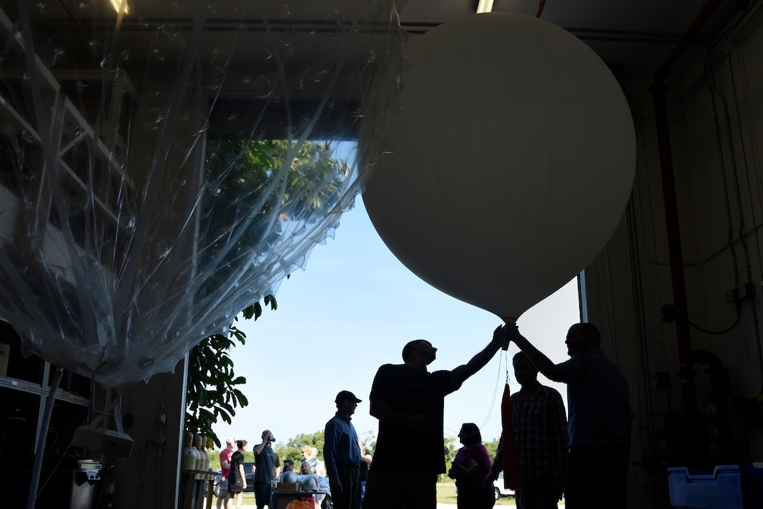 45th Weather Squadron Airmen give families a weather balloon demonstration during the 45th Space Wing Family Day self guided tour of Cape Canaveral Air Force Station, Fla. on April 6, 2019.