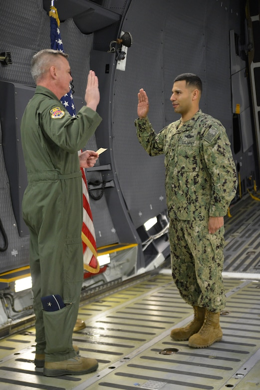 Seaman reenlists aboard a Super Galaxy