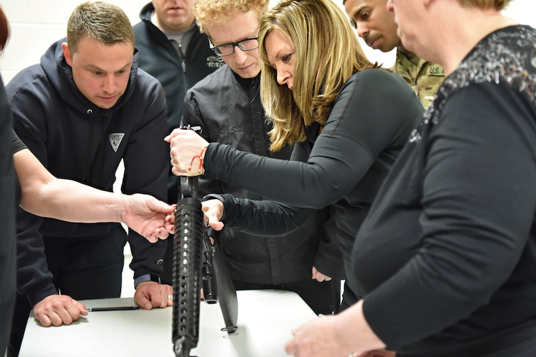 Honorary Commander Regina Arcuri is shown how to assemble a rifle at Joint Base McGuire-Dix-Lakehurst, New Jersey, April 5, 2019.  The Honorary Commander program provides a unique experience to key community leaders, giving them hands on military training.  (U.S. Air Force photo by 1st Lt. Jaclyn Sumayao)