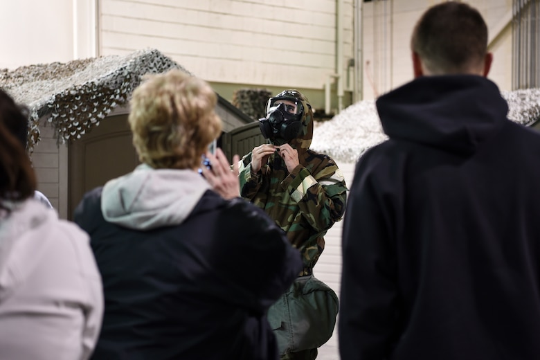 An Honorary Commander dons protective gear at Joint Base McGuire-Dix-Lakehurst, New Jersey, April 5, 2019.  Honorary Commanders are given a crash course on wearing protective gear to understand the purpose of the equipment and catch a glimpse of military life.  (U.S. Air Force photo by 1st Lt. Jaclyn Sumayao)