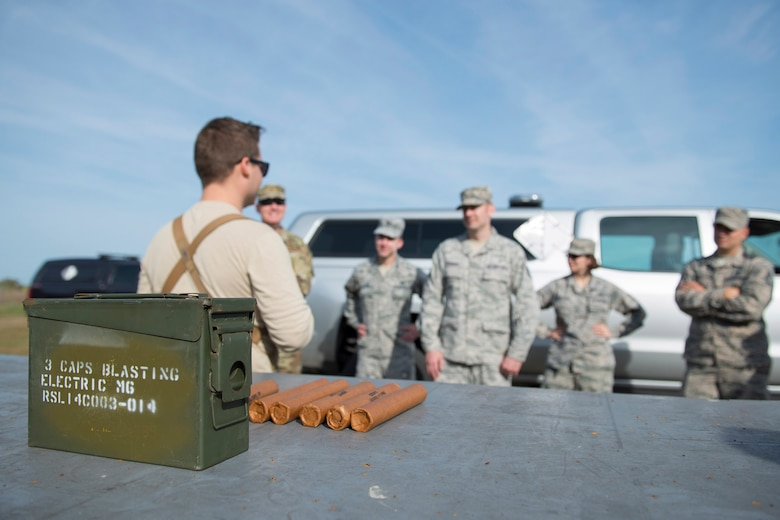 U.S. Air Force Staff Sgt. Evan Weier, an explosive ordnance disposal technician with the 45th Civil Engineer Squadron's EOD flight, gives a safety briefing to members of the Air Force Technical Applications Center prior to detonating explosives at Cape Canaveral Air Force Station, Florida, March 13, 2019.  Weier and his EOD co-workers assisted members of AFTAC's Systems Development Directorate with testing a prototype geodesic dome to help the nuclear treaty monitoring center capture hydroacoustic data. (U.S. Air Force photo by Matthew S. Jurgens)
