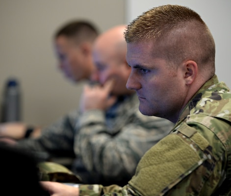 "Members of the 833rd Cyberspace Operations Squadron participate in the monthly 567th Cyberspace Operations Group ""hunt exercise"" at Joint Base San Antonio-Lackland March 21. The three-day exercise afforded teams from the 90th, 92nd, 833rd and 834th COSs, as well as the Air Force Office of Special Investigations, the opportunity to defend against an enemy within a virtual training network."