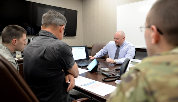 "Members of the 92nd Cyberspace Operations Squadron brief 567th Cyberspace Operations Group ""hunt exercise"" judges on their findings during the exercise at Joint Base San Antonio-Lackland March 22. The three-day exercise afforded teams from the 90th, 92nd, 833rd and 834th COSs, as well as the Air Force Office of Special Investigations, the opportunity to defend against an enemy within a virtual training network."