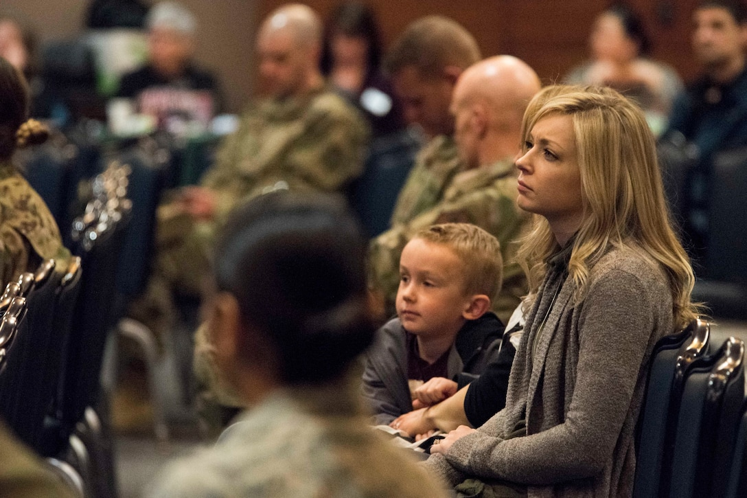 Nikki Shuler, wife of U.S. Air Force Capt. Alex Shuler, a 90th Fighter Squadron F-22 Raptor pilot, listens to resource providers during a welcome reception at Joint Base Elmendorf-Richardson, Alaska, April 8, 2019. The JBER Support to Tyndall Airmen and Families Reception was a one-stop information fair connecting them with the appropriate agencies to address their immediate and specific needs and to learn more about services they offer.
