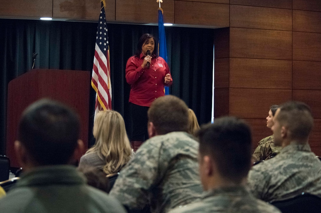 Paola Pacheco, a Military One Source state consultant, speaks during a welcome reception at Joint Base Elmendorf-Richardson, Alaska, April 8, 2019. The JBER Support to Tyndall Airmen and Families Reception was a one-stop information fair connecting them with the appropriate agencies to address their immediate and specific needs and to learn more about services they offer.