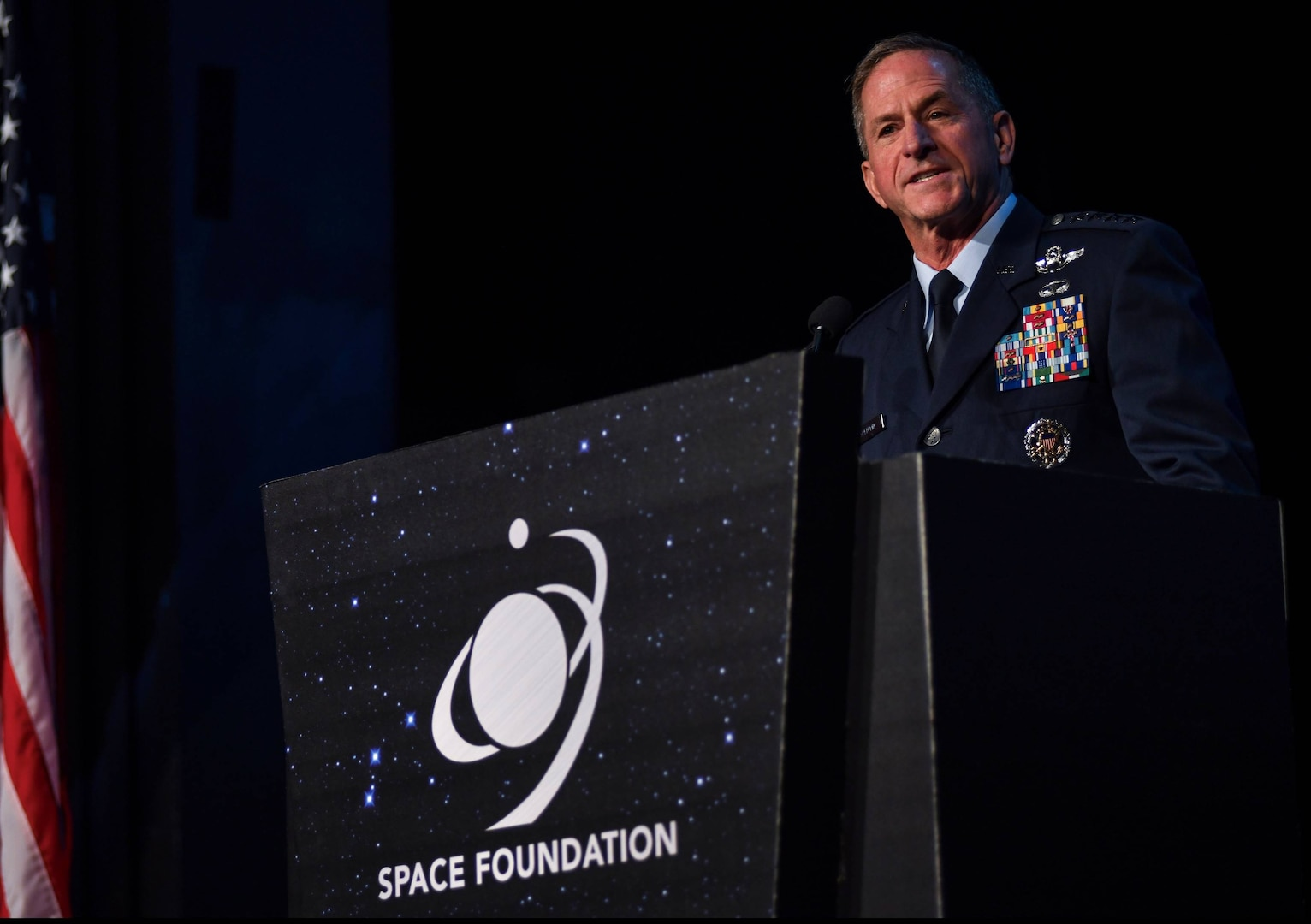 """Air Force Chief of Staff Gen. David L. Goldfein emphasized the importance of allies and partners during a speech April 9, 2019, at the 35th Space Symposium in Colorado Springs, Colo. """"We prefer the power of collaboration over coercion"""" to maintain space dominance, Goldfein said. (U.S. Air Force photo by Airman 1st Class Michael Mathews)"""