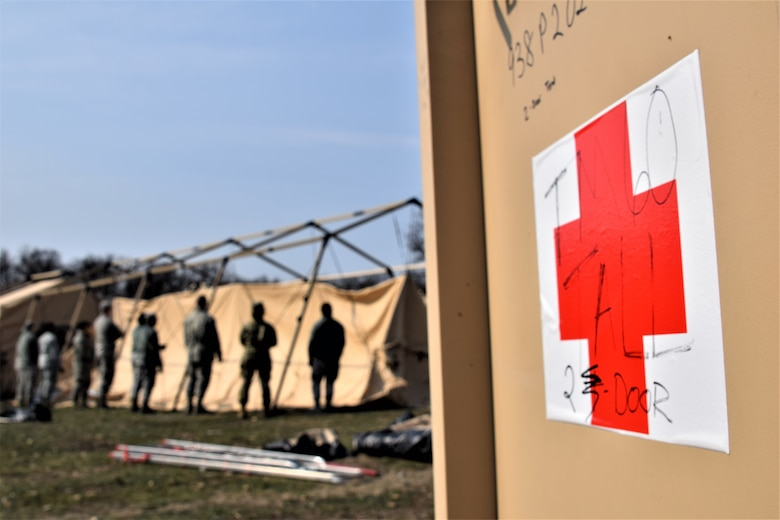 Airmen from the 86th Medical Group, Ramstein Air Base, Germany, prepare Role 2 (field hospital) expeditionary medical support facilities at Cincu Military Base, Romania