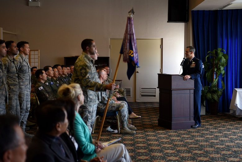 U.S. Air Force Lt. Gen. Kenneth Wilsbach, Seventh Air Force commander, speaks at an assumption of command ceremony for the 607th Air Operations Center at Osan Air Base, Republic of Korea, April 5, 2019. Wilsbach spoke about Col. Christopher Russell, the incoming commander, who has commanded operations centers at Joint Base Pearl Harbor-Hickam, Hawaii and Joint Base San Antonio-Lackland, Texas. (U.S. Air Force photo by Staff Sgt. Kelsey Tucker)