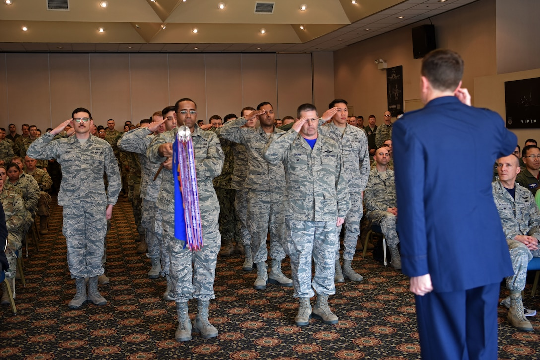 Members of the 607th Air Operations Center render a first salute to their new commander, U.S. Air Force Col. Christopher Russell, during his assumption of command ceremony at Osan Air Base, Republic of Korea, April 5, 2019. Russell assumed commander of the most-forward deployed AOC in the world. The 607th's mission is to plan, command and control, execute and assess air, space and information operations to meet Secretary of Defense, Pacific Air Force Forces and USFK taskings across the spectrum of military operations. (U.S. Air Force photo by Staff Sgt. Kelsey Tucker)