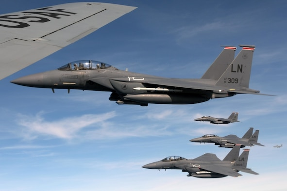 U.S. Air Force F-15E Strike Eagles assigned to the 494th Fighter Squadron at RAF Lakenheath, England, fly along-side a 100th Air Refueling Wing KC-135 Stratotanker near the North Sea, England, March 20, 2019. The KC-135 offloaded approximately 42,000 pounds of fuel to the F-15s. (U.S. Air Force photo by Senior Airman Benjamin Cooper)