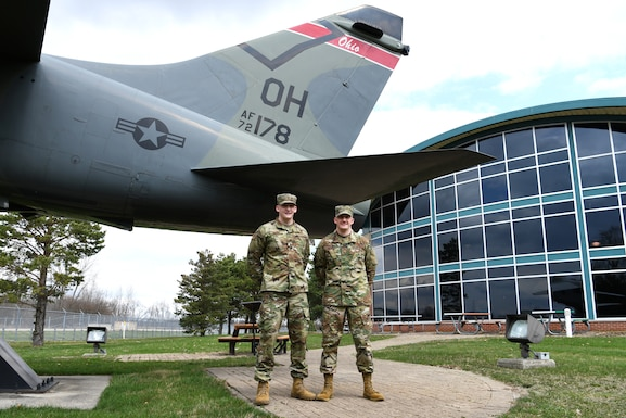 photo of Crum brothers in front of static display