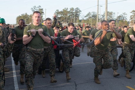 U.S. Marines with 8th Engineer Support Battalion, 2nd Marine Logistics Group, pull a chariot that they built while competing in the Marine Corps Engineer School Saint Patrick's Day Field Meet on Camp Lejeune, North Carolina, March 14, 2019. Marines competed in the field meet to strengthen community and camaraderie in the spirit of friendly competition