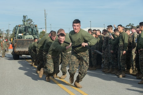 U.S. Marines with 8th Engineer Support Battalion, 2nd Marine Logistics Group, pull a Backhoe Loader while competing in the Marine Corps Engineer School Saint Patrick's Day Field Meet on Camp Lejeune, North Carolina, March 14, 2019. Marines competed in the field meet to strengthen community and camaraderie in the spirit of friendly competition.